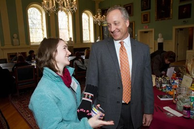 """Once I start thinking of all the people who deserve my gratitude, I realize that I have a lot of notes to write,"" said FAS Dean Michael D. Smith (right), who chatted with student volunteer Mackenzie Hild '14 in University Hall."