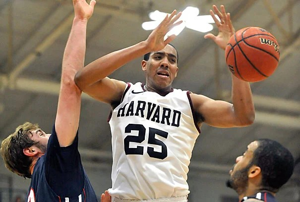 Kenyatta Smith '15 takes a shot at Friday's game. Smith established a new Harvard single-game record with 10 blocks, and finished with a career-best 20 points.