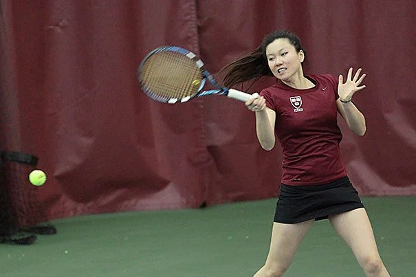 Hideko Tachibana '13 hits a hard forehand during her doubles match with partner Hannah Morrill '14.