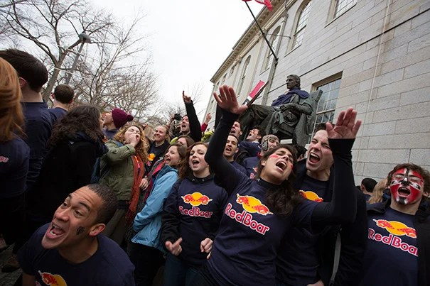 Kirkland House students defend the John Harvard Statue, which they were up earliest to claim on Housing Day. Freshmen, who spend their first year on campus in dormitories in Harvard Yard, were sorted into one of Harvard's 12 Houses on March 14.