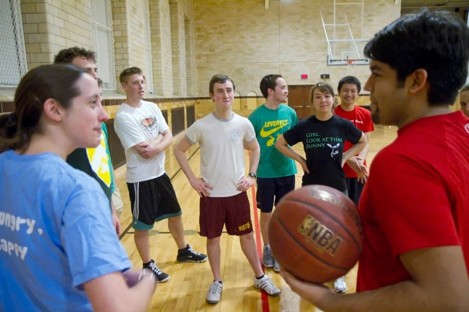 Leverett House basketball Team C members choose sides for an intrasquad game after another House failed to show up for their scheduled contest.