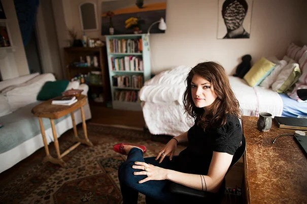 Dudley Co-op resident Charlotte Lieberman '13 is pictured in her room in one of the two Victorian houses nestled in a residential neighborhood just outside Harvard Square.