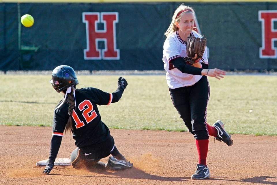 Emily Gusse '15 fires to first to complete a double play after forcing out the runner at second. Gusse was 2-for-4 with two runs and two RBIs for the game.