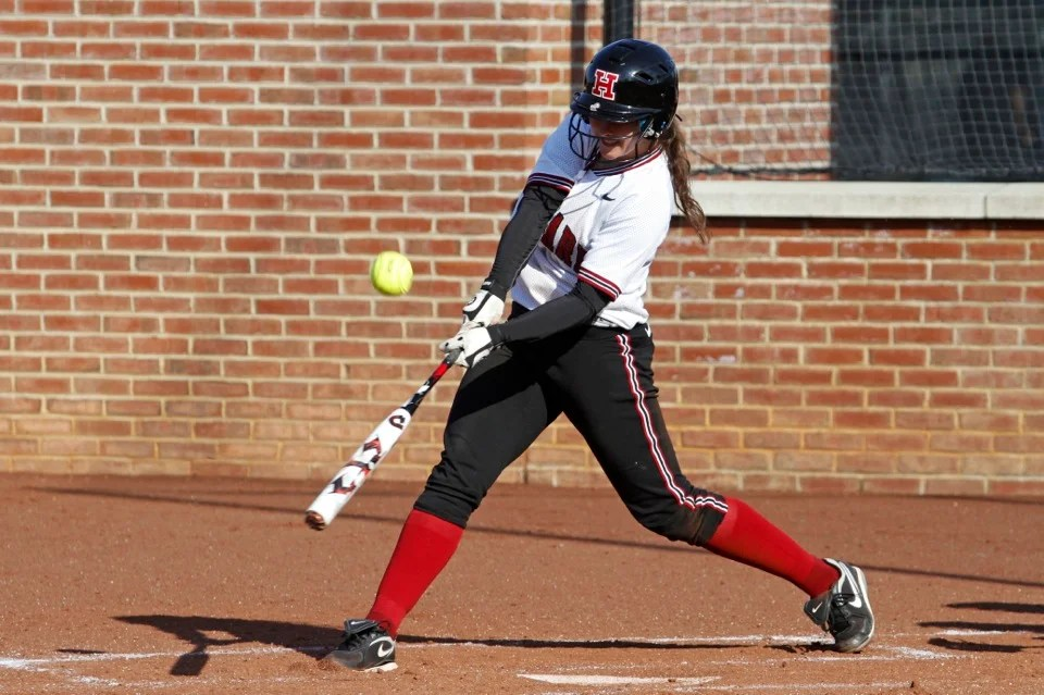 Kasey Lange '14 connects. Lange had two hits and knocked in three RBIs.
