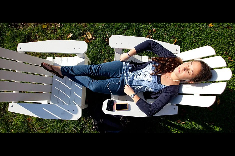 Michelle Haan '12, who lives in Pforzheimer House, enjoys the sun and sounds from her iPod on the Radcliffe Quadrangle. Rose Lincoln/Harvard Staff Photographer