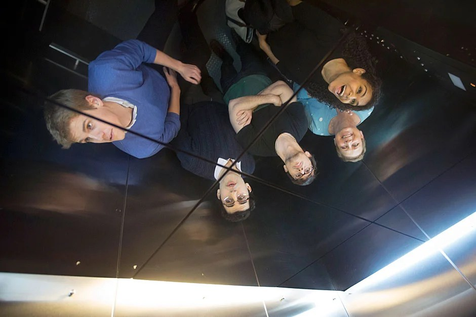 Rhodes Scholars from Quincy House, Benjamin B.H. Wilcox '13 (from left), Julian B. Gewirtz '13, Aidan C. de B. Daly '13, House Co-Master Deb Gehrke, and Nina M. Yancy '13 are pictured reflected in the House elevator ceiling on their way up to the sixth floor, where the students all resided. Kris Snibbe/Harvard Staff Photographer
