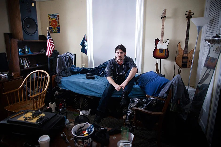 """Linguistics concentrator Parker Crane '13 called Cambridge his hometown and the Dudley Co-op his residence. He enjoyed the indirect sunshine that bounced off the front porch and gave his room """"nice atmospheric light without it being too harsh at any point of the day."""" Stephanie Mitchell/Harvard Staff Photographer"""
