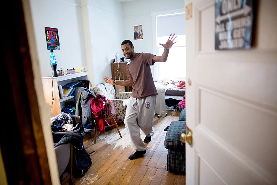 """Malik Knox '13, a sociology concentrator from Baltimore, loved having a lot of space in his room for friends to visit. Speaking about the community at the Dudley Co-op, he said, """"I love the people here. Everyone is on the same page about being part of a community. We are all different in many ways. We all have each other's back. I feel like I can be myself here."""" Stephanie Mitchell/Harvard Staff Photographer"""