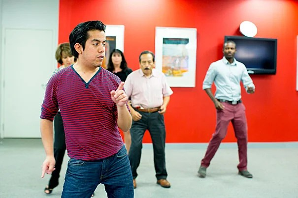 Professional ballroom dancer Marco Perez-Moreno '13 teaches a salsa move to Minoo Ghoreishi (from left), Gail Olivier, Pedro Romero, and Asare Christian (photo 1); David and Angela Franks practice what they've learned (photo 2); and Asare Christian can't help but smile (photo 3).