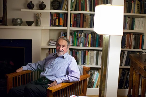 Harvard Professor Emeritus Martin Karplus is one of three winners of this year's Nobel Prize in chemistry. He is pictured at home in Cambridge, Mass., moments after hearing the news (photo 1). Karplus fielded calls from Swedish, French, American, and other European news outlets (photo 2). At a reception later in the day, Professor George Whitesides (right)  delivered a toast to Karplus (left) as colleagues and well-wishers gathered in the Chemistry Library (photo 3).