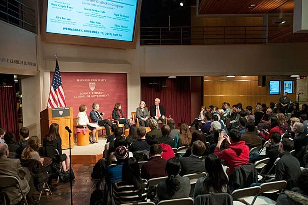 "A panel on capital partisanship and gridlock at Harvard Kennedy School brought together scholars from near and far. Moderated by Karen Gordon Mills '75, M.B.A. '77 (photo 2), the panel was introduced by Harvard President Drew Faust (photo 3), who said, ""Around the world, people looked at us and scratched their heads and began to wonder about the United States: Is the American Experiment unraveling? I think we all are searching for answers."""