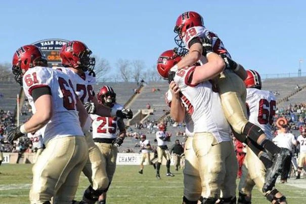 Paul Stanton and the Crimson earned a share of the Ivy League title with a 34-7 battering of Yale Saturday.