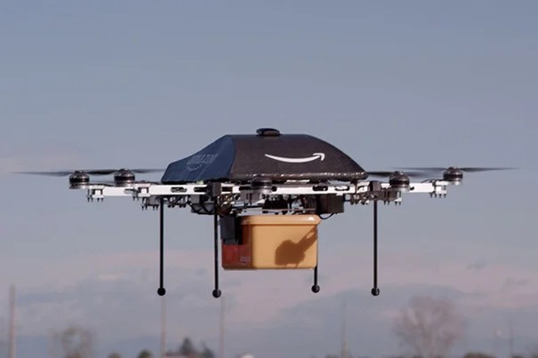 "Amazon founder and CEO Jeff Bezos said he wants to use Amazon-branded drones (pictured) to deliver small packages within 30 minutes of placing an order. Harvard Professor Robert Wood, who builds insect-sized flying robots, said the technology to do so is actually ""quite close."""