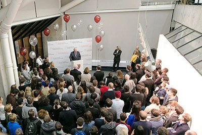 """John K.F. Irving (at podium) announced a $10 million gift to the Graduate School of Design on Wednesday. """"This gift is not about promoting a single program — this gift is about the future of the School in a world facing increasingly complex challenges,"""" said Irving."""