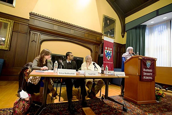 "Harvard Divinity School student Usra Ghazi (at podium), a junior fellow at the Center for the Study of World Religions, moderated a panel titled ""Faith-Based Community Organizing: How Working With the Religious Other Can Save the World."""