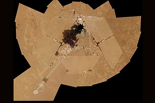 NASA's Mars exploration rover Opportunity recorded the component images for this self-portrait about three weeks before completing a decade of work on Mars (photo 1). Researchers used Opportunity to find a water-related mineral on the ground that had been detected from orbit. The mineral was located in the dark veneer of rocks on the rim of a crater named Endeavour. The brushed area is about 1.5 inches wide (photo 2).