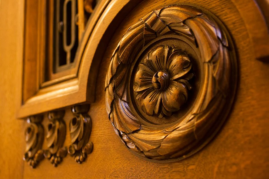 Intricate woodcarvings adorn the entrance to the room.