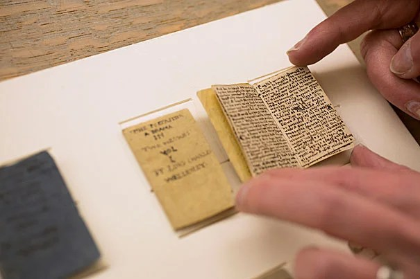 "Nine miniature manuscript books (photos 1, 3), six by Charlotte Brontë and three by Patrick Branwell Brontë, are part of the collections at Houghton Library. The library repaired, rehoused, and digitized the books, which are nearly 200 years old. ""These tiny books help to evoke the whole experience of the Brontë children,"" says Houghton curator Leslie Morris (photo 2)."