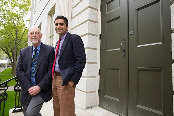 """Both Donald Pfister (left) and Rakesh Khurana believe strongly that an important role for the dean is to foster and build the College community of learning. """"My goals were modest in a way, but they were really about reaching out and connecting with the students, and working within the College to make sure we weren't merely in a transition, but moving the College forward,"""" said Pfister, who now turns the reins over to Khurana."""