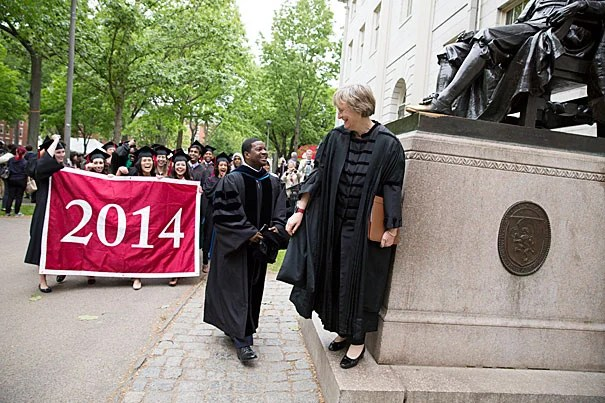 """Plummer Professor of Christian Morals and Pusey Minister Jonathan Walton and Harvard President Drew Faust led a procession (photo 1) into Memorial Church for the annual Baccalaureate Service, during which Faust urged seniors like Katie Hernandez (left, photo 2) and Caroline Davis to """"break good,"""" """"face outward,"""" and act for the betterment of the larger community. """"This week is neither one of culmination nor conclusion,"""" said Walton in his talk. """"It is Commencement. It is just the beginning."""""""