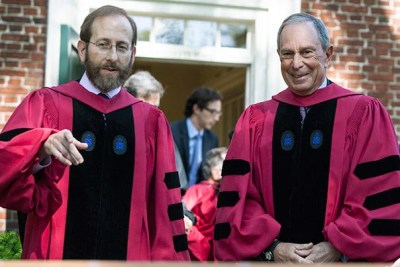Harvard Provost Alan M. Garber (left, photo 1) and Michael R. Bloomberg, the principal speaker at Afternoon Exercises, prepare for the walk to Tercentenary Theatre to begin the morning portion of Commencement. President Drew Faust (photo 2) shares a moment with former President George H.W. Bush. Evelynn Hammonds (left, photo 3) escorts Aretha Franklin, one of the eight honorary degree recipients.