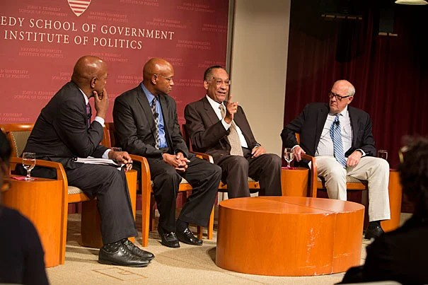 "A panel convened by Professor Charles Ogletree (from left) reflected on the broad social, legal, and political issues raised by the protests in Ferguson, Mo., last month. ""I'm not alleging any type of conspiracy. Just know that many people — minority and majority — think something is terribly wrong,"" said the Rev. Ray Hammond. Also on the panel were Lee P. Brown, the first African-American commissioner of police for Atlanta, and Alex Jones, director of the Shorenstein Center."