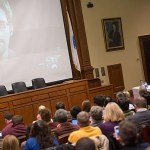 By videoconference, Harvard Professor Lawrence Lessig interviewed Edward Snowden (on screen, photo 1), the former National Security Agency contractor who leaked more than 200,000 classified documents about U.S. surveillance efforts. Lessig (photos 2, 3) used technology to bring Snowden into the crowded Ames Courtroom, where the two spoke frankly about Snowden's actions.