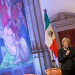 """The research interests that spark connections between Harvard and Mexico are extraordinarily varied — from archaeology to the arts, from education to public health, to economics, politics, [and] public policy,"" said Harvard President Drew Faust (photo 1), who later answered questions at the Your Harvard event in Mexico City's Colegio de San Ildefonso. Jorge Dominguez (from left, photo 2) led a panel discussion with Mary Schneider Enriquez, Alejandro Ramírez Magaña, Laura Alfaro, and Julio Frenk before a packed audience (photo 3) also during Tuesday's event."