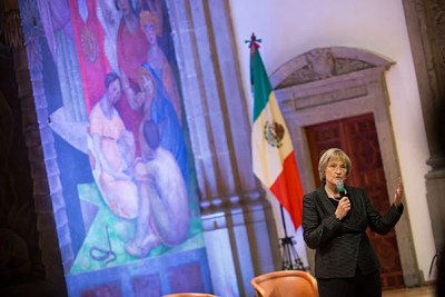 """""""The research interests that spark connections between Harvard and Mexico are extraordinarily varied — from archaeology to the arts, from education to public health, to economics, politics, [and] public policy,"""" said Harvard President Drew Faust (photo 1), who later answered questions at the Your Harvard event in Mexico City's Colegio de San Ildefonso. Jorge Dominguez (from left, photo 2) led a panel discussion with Mary Schneider Enriquez, Alejandro Ramírez Magaña, Laura Alfaro, and Julio Frenk before a packed audience (photo 3) also during Tuesday's event."""