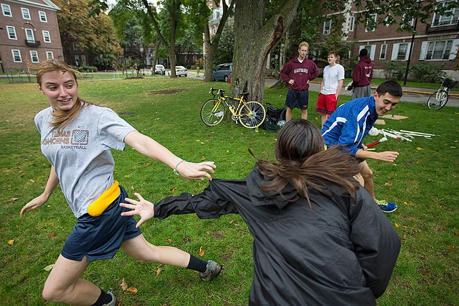 Monica Marion '17 (left) and Phillip Ramirez '18 (right) make a dash during Quidditch.