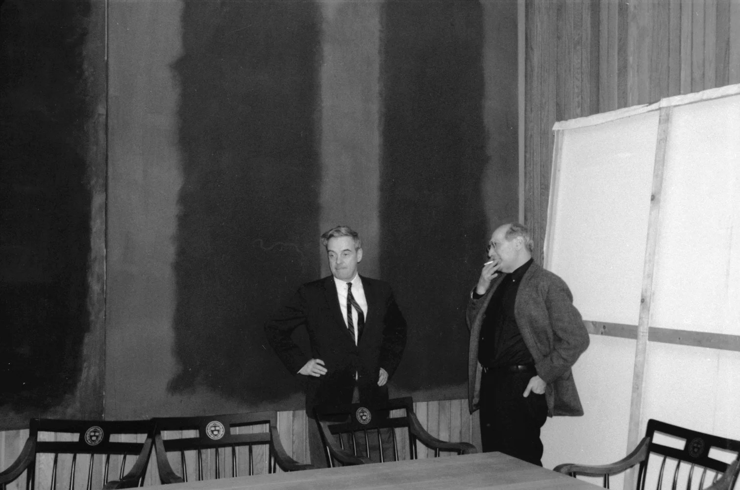 "John Coolidge, former director of the Fogg Museum, and Mark Rothko (right) in front of ""Panel Two"" and ""Panel Three"" of the Harvard murals on the tenth floor of Harvard's Holyoke Center, 1963. © 2009 Kate Rothko Prizel and Christopher Rothko / Artists Rights Society (ARS), New York. Elizabeth H. Jones, ©President and Fellows of Harvard College"