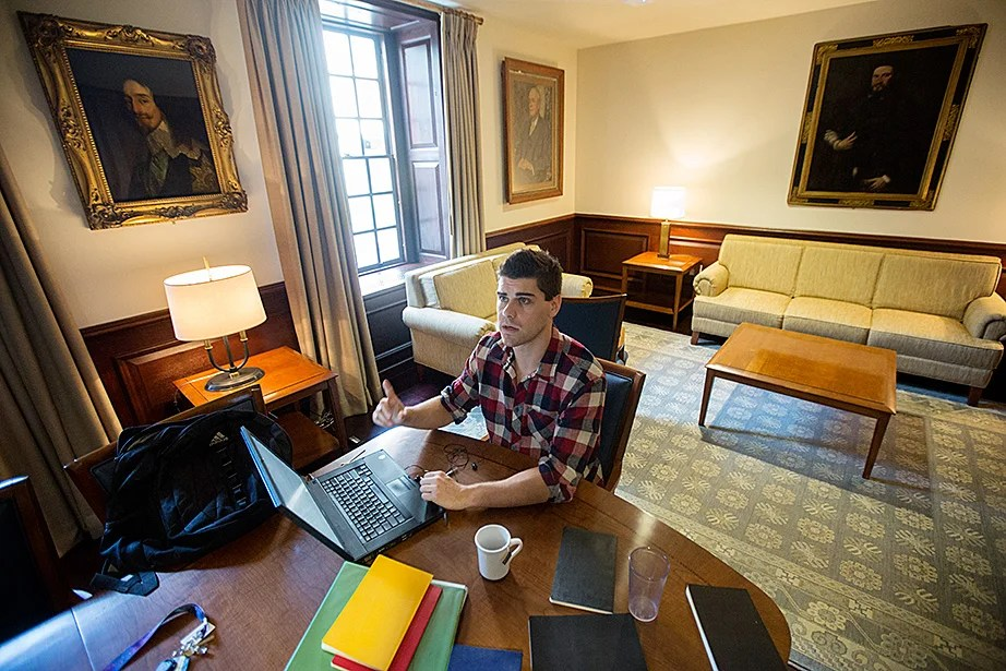 "Jason Light '15 studies inside McKinlock Hall. ""The House renewal did an amazing job of finding that balance between the social and studious parts of a student's schedule. I can do my studying in one of the many common spaces around the building one moment, and then head downstairs to play a quick game of pool the next,"" said Light. Kris Snibbe/Harvard Staff Photographer"