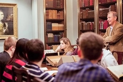 At Houghton Library, Harvard Shakespeare scholar Stephen Greenblatt (far right, photo 1), guides Humanities 10a students through a look at first editions and other treasures. Harvard cultural historian and English professor Louis Menand (center, photo 2) joined Humanities 10a students Mitchell Edwards '18 (left) and Alexandra Walsh '18 (right) at Houghton Library, where class visitors examined letters, folios, and first editions.
