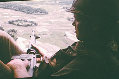 """Two stills from the film """"Hearts and Minds"""" (1974): An American soldier on helicopter patrol over South Vietnam (photo 1). A villager in North Vietnam after an American bombing raid killed his mother and his two children, ages 8 and 3 (photo 2)."""