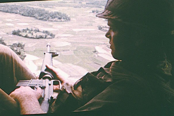 "Two stills from the film ""Hearts and Minds"" (1974): An American soldier on helicopter patrol over South Vietnam (photo 1). A villager in North Vietnam after an American bombing raid killed his mother and his two children, ages 8 and 3 (photo 2)."