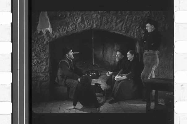 """""""Oidhche Sheanchais"""" (""""A Night of Storytelling"""") by pioneer film documentarian Robert J. Flaherty used a hearthside set (image 1) and featured the cast of """"Man of Aran"""" (1935), including Michael Dillane (image 2). The only known print of the 1935 short, the first """"talkie"""" in Gaelic, was rediscovered at Houghton Library, restored, and will have its U.S. premiere during """"The Lost Worlds of Robert Flaherty,"""" a Jan. 30–March 1 Harvard Film Archive series."""