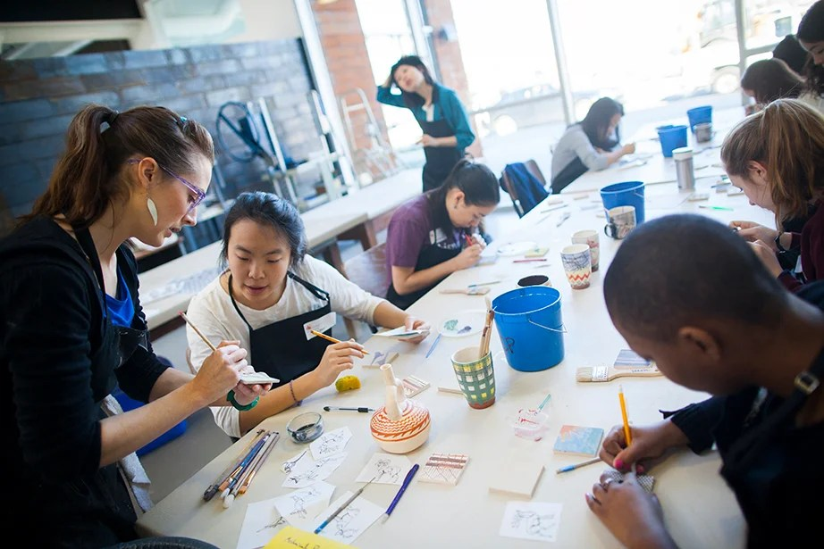 Jessica Brandl teaches printmaking on clay as a Wintersession class at the Harvard Ceramics Program. From the graphic to the painterly, techniques include traditional printmaking techniques such as mono-printing, silk-screening, and stenciling onto clay. Brandl (from left) speaks with Amy Zhao '18 during class. Stephanie Mitchell/Harvard Staff Photographer