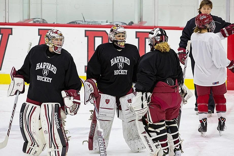 Crimson goalies Brianna Laing '17, left, Emerance Maschmeyer '16, center, and Molly Tissenbaum '17, far right, converge for an impromptu meeting at mid-ice. Jon Chase/Harvard Staff Photographer