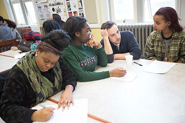 """Brendan Shea (third from left), manager of education and community programs at the American Repertory Theater (A.R.T.), worked with Boston Green Academy seniors Kimberly Kirlew (from left), Joyce Ogbesoyen, and Ester Farah during a workshop that focused on the A.R.T.'s production of Suzan-Lori Parks' """"Father Comes Home From the Wars (Parts 1, 2, & 3)."""""""