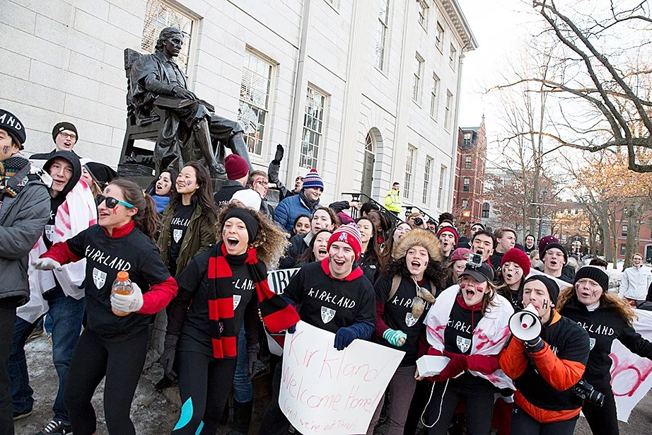 Spirited upperclassmen from Kirkland House were up before 7 a.m. and, like last year, were first to claim the John Harvard Statue on Harvard's Housing Day. Rose Lincoln/Harvard Staff Photographer