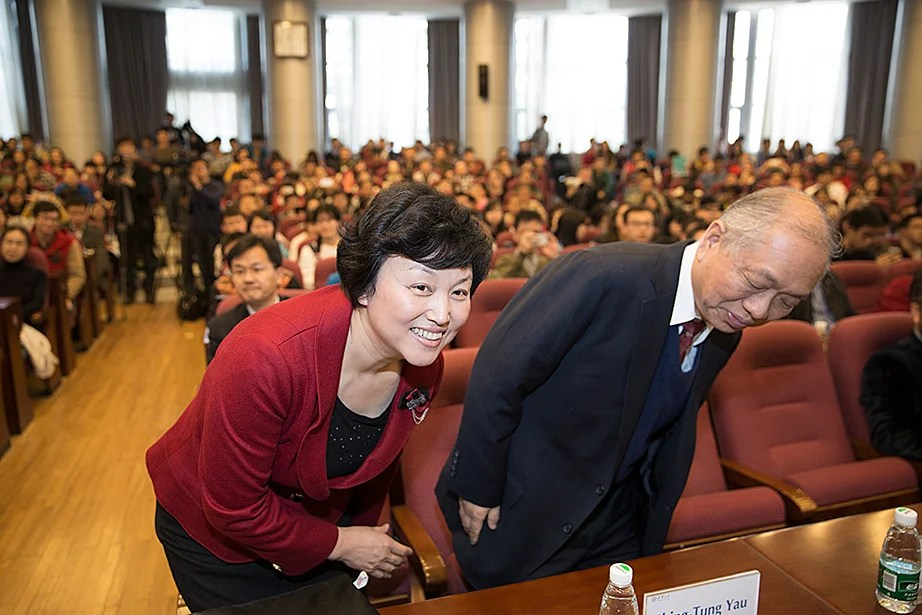 "Chen Xu (left), party secretary of Tsinghua University, and William Caspar Graustein Professor of Mathematics and Professor of Physics Shing-Tung Yau listen to the Tsinghua Global Vision Lecture, ""Universities and the Challenge of Global Climate Change"" at Tsinghua University."