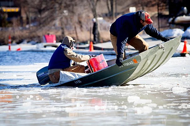 Assistant coaches Patrick Lapage (front, photo 1) breaks up ice on the Charles with Ian Accomando. Boston's snowy weather has forced the team into practicing more indoors this year (photo 2).