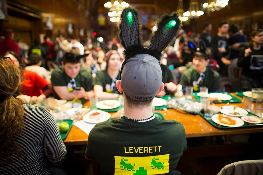 A Leverett House student dines in his bunny ears. Stephanie Mitchell/Harvard Staff Photographer