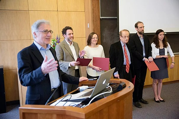 Douglas Melton (from left, photo 1), Xander University Professor of Stem Cell and Regenerative Biology, presented Star Family Challenge awards to five Harvard faculty: Joshua Greene, Paola Arlotta, Federico Capasso, David Keith, and accepting for Daniel Schrag was research assistant Lauren Benson Kuntz. The awards were presented at Lamont Library (photo 2).