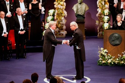 """Brian Schmidt (left), now a distinguished professor at the Australian National University, received the 2011 Nobel Prize in physics for determining that the universe's expansion was accelerating. His return to campus is a homecoming — he completed his Ph.D. at Harvard and called it """"arguably the best time of my life."""""""