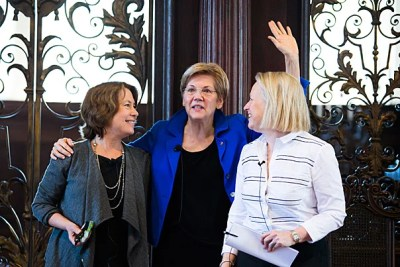 Three of Wall Street's toughest critics — Sheila Bair (from left, photo 1), Sen. Elizabeth Warren, and Mary Schapiro — came to Harvard to talk about gender and taking on what's been called America's ultimate boys' club. Pulitzer Prize–winning journalist Ron Suskind (photo 2), now a fellow at the Edmond J. Safra Center for Ethics, hosted the discussion at the Memorial Church.