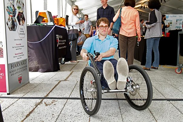 Harvard SEAS students presented projects developed throughout the school year at the SEAS Design and Project Fair. Joe Pappas '17 rode the Crimson Cruiser, a lightweight go-kart designed to run on minimal electrical energy. Photo by Kiera Blessing
