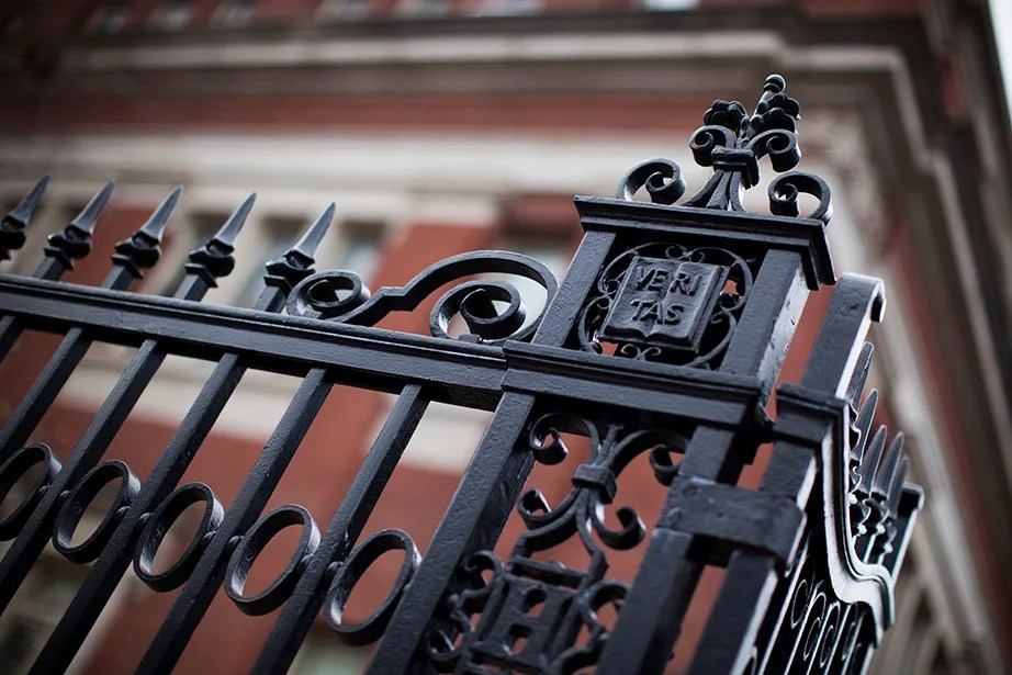 On a Harvard Yard fence along Quincy Street.