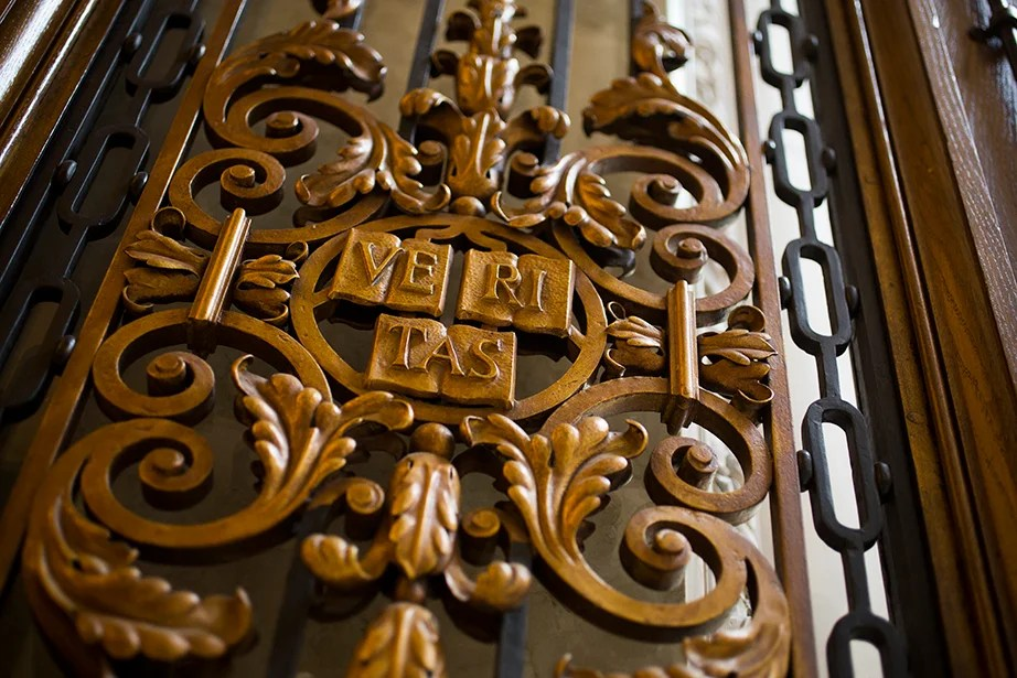 A Veritas shield in wrought iron at the entrance to the Harry Elkins Widener Memorial Library.