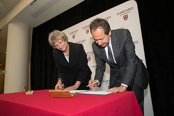A signing ceremony with  John A. Paulson, M.B.A. '80, and President Drew Faust marked the celebration of Harvard's largest gift. The $400 million will  support research, teaching, financial aid, and faculty development for Harvard's School of Engineering and Applied Sciences, which has been renamed in honor of Paulson.
